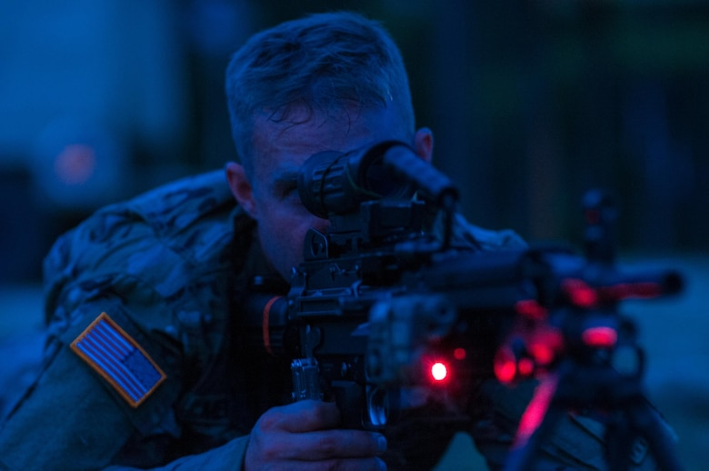 Sgt. Ben Mercer with the 416th Theater Engineer Command and a member of the U.S. Army Reserve Marksmanship team sights his M249 Squad Automatic Weapon, or SAW, before a night-fire event during the first day of the U.S. Army Forces Command Weapons Marksmanship Competition Sept. 21, 2015, at Fort Bragg, N.C. The three-day FORSCOM competition features 27 marksmen from the U.S. Army, U.S. Army Reserve, and the National Guard in events for the M9 pistol, the M4A1 rifle, and the M249, to recognize Soldiers who are beyond expert marksmen. The multi-tiered events challenge the competitors' ability to accurately and quickly engage targets in a variety of conditions and environments. (U.S. Army photo by Timothy L. Hale/Released)