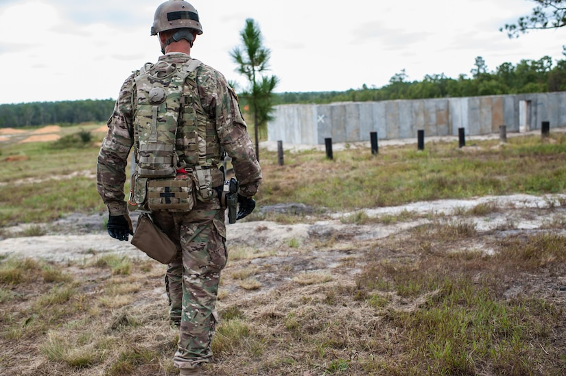 Master Sgt. Russell Moore, with the 416th Theater Engineer Command and a member of the U.S. Army Reserve Marksmanship Team, moves to a firing position for the Robotic Human Type Target scenario during the second day of the U.S. Army Forces Command Weapons Marksmanship Competition Sept. 22, 2015, at Fort Bragg, N.C. The three-day FORSCOM competition features 27 marksmen from the U.S. Army, U.S. Army Reserve, and the National Guard in events for the M9 pistol, the M4A1 rifle, and the M249 SAW, or Squad Automatic Weapon, to recognize Soldiers who are beyond expert marksmen. The multi-tiered events challenge the competitors' ability to accurately and quickly engage targets in a variety of conditions and environments. (U.S. Army photo by Timothy L. Hale/Released)