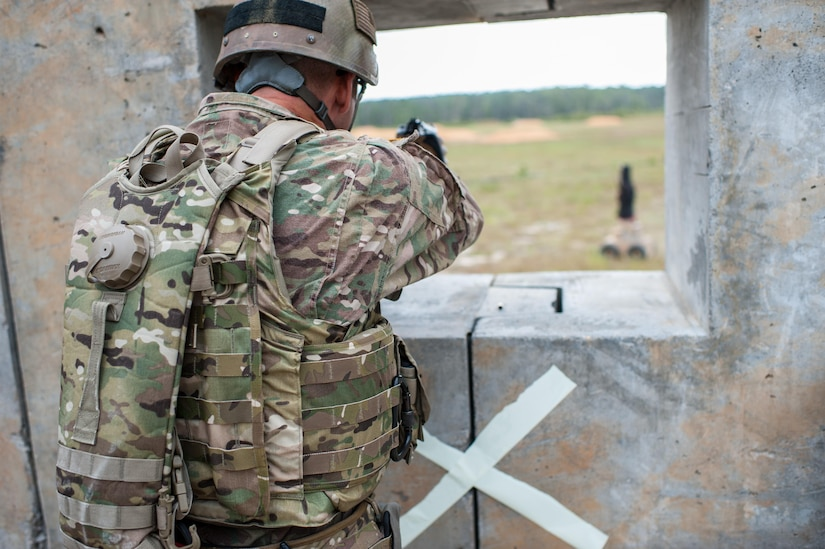 Master Sgt. Russell Moore, with the 416th Theater Engineer Command and a member of the U.S. Army Reserve Marksmanship Team, engages targets during the Robotic Human Type Target scenario at the second day of the U.S. Army Forces Command Weapons Marksmanship Competition Sept. 22, 2015, at Fort Bragg, N.C. The three-day FORSCOM competition features 27 marksmen from the U.S. Army, U.S. Army Reserve, and the National Guard in events for the M9 pistol, the M4A1 rifle, and the M249 SAW, or Squad Automatic Weapon, to recognize Soldiers who are beyond expert marksmen. The multi-tiered events challenge the competitors' ability to accurately and quickly engage targets in a variety of conditions and environments. (U.S. Army photo by Timothy L. Hale/Released)