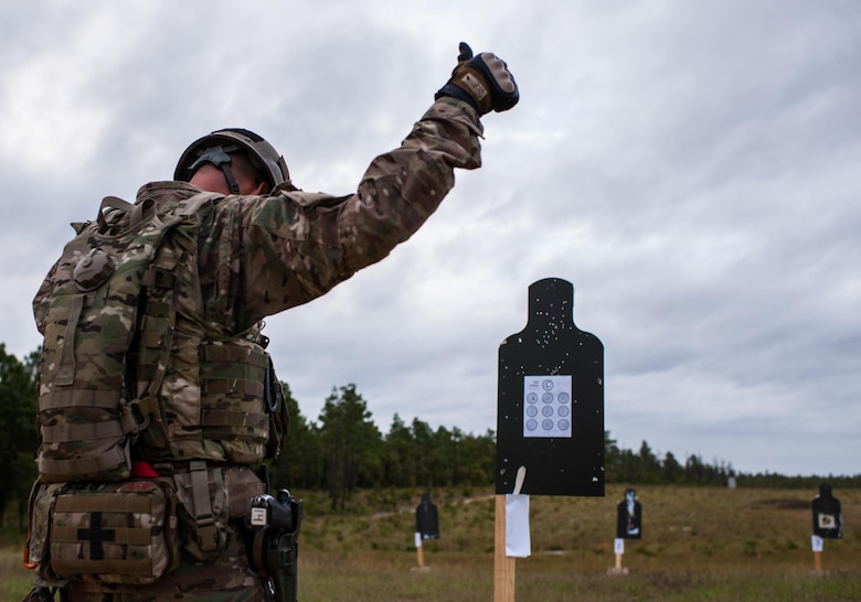 Master Sgt. Russell Moore, with the 416th Theater Engineer Command and a member of the U.S. Army Reserve Marksmanship Team, indicates he is ready to being another round of the M9 pistol Dot Torture event on the final day of the U.S. Army Forces Command Weapons Marksmanship Competition Sept. 23, 2015, at Fort Bragg, N.C. The three-day FORSCOM competition features 27 marksmen from the U.S. Army, U.S. Army Reserve and the National Guard in events for the M9 pistol, the M4A1 rifle and the M249 SAW, or Squad Automatic Weapon, to recognize Soldiers who are beyond expert marksmen. The multi-tiered events challenge the competitors' ability to accurately and quickly engage targets in a variety of conditions and environments. (U.S. Army photo by Timothy L. Hale/Released)