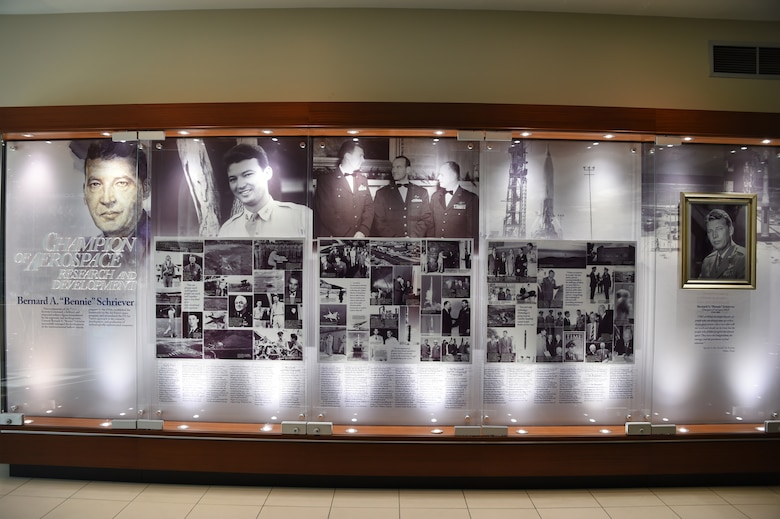 A new SMC History Office heritage display case was recently installed in the lobby of Bldg. 270 of the Space and Missile Systems Center at Los Angeles Air Force Base in El Segundo, Calif. The display depicts milestone events in the life of Gen. Bernard A. Schreiver, the legendary Architect of Air Force space and missile programs. (U.S. Air Force Photo/Joseph Juarez, Sr.)
