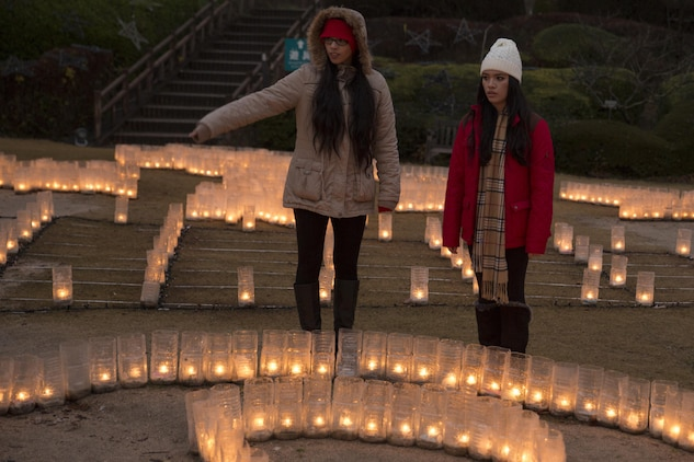 Haily Galarza, left, and Michelle Vazquez, program assistants with the Youth and Teen Center at Marine Corps Air Station Iwakuni view a candle display at the Hiroshima Botanical Garden in Hiroshima City, Japan, Dec. 23, 2015. Residents were provided the opportunity to take group photos with a giant wreath, enjoy illuminated dinosaurs and the maze of light.