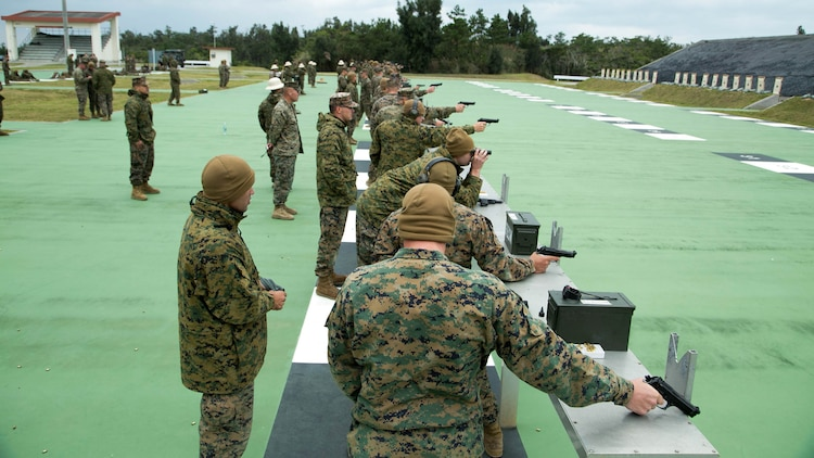 Shooters fire pistols during the Far East Division Marksmanship Match Dec. 17 aboard Camp Hansen, Okinawa, Japan. The competition consisted of classes, practice, and qualifications for both pistol and rifle marksmanship. Marine Aircraft Team 36 won the pistol marksmanship competition and 4th Marine Regiment won the rifle marksmanship competition.