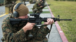 Cpl. James R. Beck, a Fixed-Wing Aircraft Power Plants Mechanic from Marine Corps Air Station Iwakuni, fires on his target during the Far East Division Marksmanship Match Dec. 17 aboard Camp Hansen, Okinawa, Japan. The shots were fired from various shooting positions and distances. Only Marines stationed throughout Japan competed in the match.