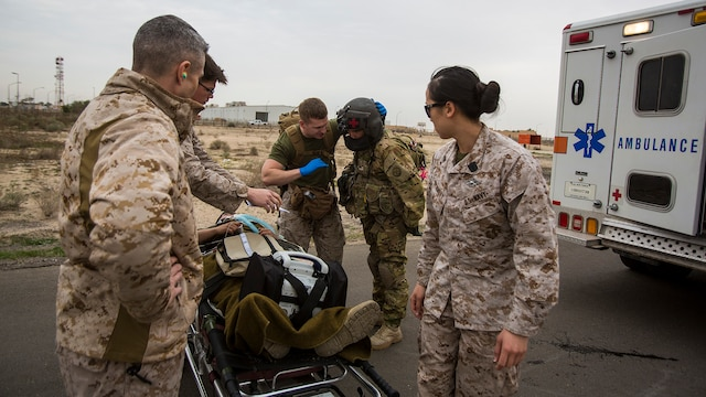 "U.S. Navy and Army medical personnel prepare to load a simulated casualty onto a UH-60 ""Black Hawk"" helicopter during a mass casualty exercise at an undisclosed location in Southwest Asia, Dec. 23, 2015. Canadian forces, U.S. Air Force and Army medical personnel, along with U.S. Marines and Navy corpsmen with Special Purpose Marine Air Ground Task Force – Crisis Response – Central Command, participated in the joint exercise to hone the coalition's medical response capabilities.  SPMAGTF-CR-CC is currently deployed to the U.S. Central Command area of responsibility with a mission spanning 20 nations."