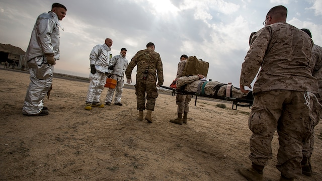 U.S. Navy and Air Force medical personnel transport a simulated casualty on a stretcher during a mass casualty exercise at an undisclosed location in Southwest Asia, Dec. 23, 2015. Canadian forces, U.S. Air Force and Army medical personnel, along with U.S. Marines and Navy corpsmen with Special Purpose Marine Air Ground Task Force – Crisis Response – Central Command, participated in the joint exercise to hone the coalition's medical response capabilities.  SPMAGTF-CR-CC is currently deployed to the U.S. Central Command area of responsibility with a mission spanning 20 nations.