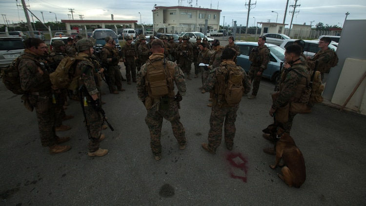 Marines with Maritime Raid Force, 31st Marine Expeditionary Unit, brief their final plan before going on a raid Dec. 10, 2015, on Camp Hansen, Okinawa, Japan. The raid is part of the MRF's Interoperability Exercise 16-1. INTEROP is the first opportunity the Force Reconnaissance Platoon, Amphibious Reconnaissance Platoon, and the rifle platoon from the MEU's Battalion Landing Team have to combine as the MRF on the 31st MEU.