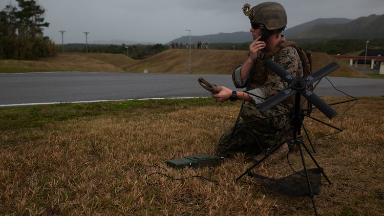 Lance Cpl. Loren Cluff sets up satellite communications for Marines with Maritime Raid Force, 31st Marine Expeditionary Unit, while they conduct a raid Dec. 10, 2015, on Camp Hansen, Okinawa, Japan. The raid was part of Interoperability Exercise 16-1, an exercise used to build a working bond between the MRF and the rest of the MEU quickly and effectively. Cluff, from Snowflake, Arizona, is a field radio operator with the Air Naval Gunfire Liaison Company Detachment, 31st Marine Expeditionary Unit.