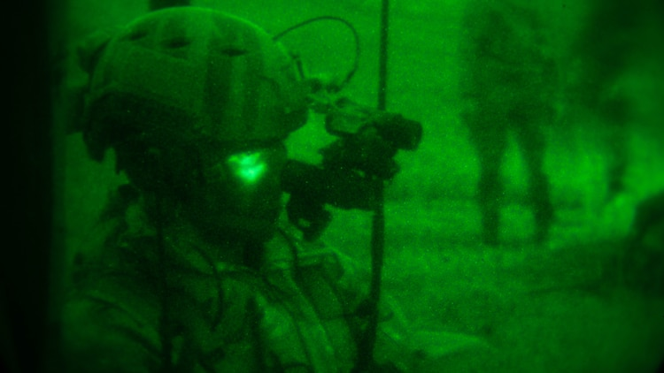 An Air Force joint terminal attack controller participates in a raid conducted by Maritime Raid Force, 31st Marine Expeditionary Unit, Dec. 14, 2015. The JTAC's acted as the eyes on the ground for aircraft supporting the raid. The raid was part of Interoperability Exercise 16-1, an exercise used to build a working bond between MRF and the rest of the MEU quickly and effectively.