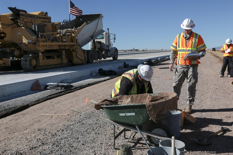 1st Lt. Luke Ritz (center), a project engineer at the District's Fort Huachuca Resident Office, ensures that the concrete for the new apron at Libby Army Airfield meets stringent design specifications. Ritz and Harold Colby (right), a construction representative from the Tucson Resident Office, oversee several tests that confirm the concrete will properly cure for maximum strength and durability.