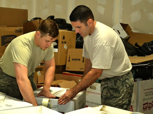 Pennsylvania Air National Guardsmen Airman 1st Class Igor Karlov, left, and Master Sgt. Joe Sommers, both from the 111th Logistics Readiness Squadron at Horsham Air Guard Station, Pa., work together to create boxes for sorting donated items at a Toys for Tots warehouse in Glenside, Pa., Dec. 22, 2015, Eight logistics and supply Airmen from Horsham AGS collected, sorted and boxed more than 1,000 donated items. (Pennsylvania Air National Guard photo/Tech. Sgt. Andria Allmond)
