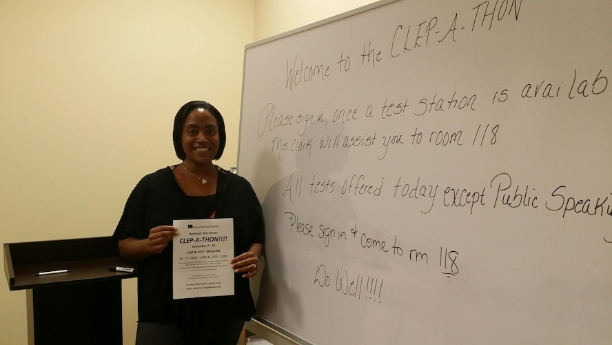 Laurice Clark, 39th Air Base Wing education center national test center coordinator, holds an advertisement for the education centers two week long CLEP-A-Thon Dec. 7, 2015, at Incirlik Air Base Turkey. The Education Center's CLEP-A-Thon offered DoD card holders the opportunity to participate in a first come first served style college level examination program and DANTES subject standardized tests as opposed to scheduling the tests. To schedule for a CLEP or DSST test contact Ms. Clark at the National Test Center at 676-3060 or send an email to ntcadana-europe@umuc.edu. (Courtesy photo)