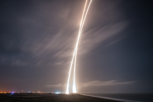 Rocket trails from the launch of a SpaceX Falcon 9 carrying ORBCOMM's OG2 communications satellites and landing of the Falcon 9's first stage booster Dec. 21, 2015, at Cape Canaveral Air Force Station, Florida. (Courtesy photo/SpaceX)