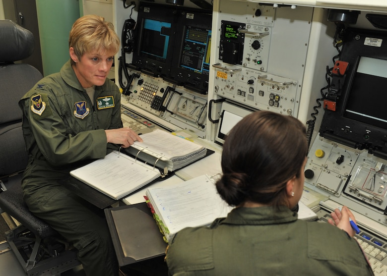 Col Kristin Goodwin, 2nd Bomb Wing commander, talks with an attendee of the Bomber Missile Exchange Course at Malmstom Air Force Base, MT., Dec. 16, 2015. The formal course is designed to occur within two one week-long phases and involves bomb wing personnel travelling to the missile wing during part one then reciprocating as hosts during week two. By targeting Airmen within the E-7, E-8 and O-2 and O-3 ranks, the goal is to ultimately build a core of mid-level Air Force Global Strike Command leaders with a broad understanding of the nuclear enterprise. (Courtesy Photo)