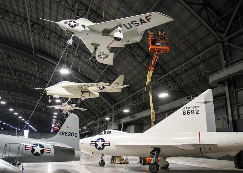 Restoration staff move the Northrop X-4 Bantam aircraft into position within the R&D Gallery at the National Museum of the U.S. Air Force in November 2015. (U.S. Air Force photo)