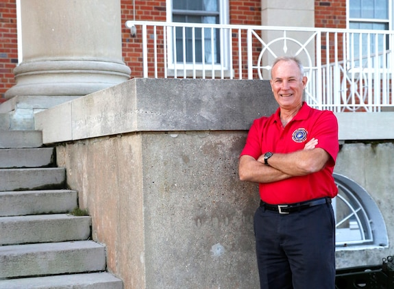 Kevin Scott, manpower, personnel and training lead for Combat Support Systems at Marine Corps Systems Command, stands in front of the command's headquarters building aboard Marine Corps Base Quantico, Virginia. MCSC is now located in what was originally Naval Hospital Quantico where Scott was born. (U.S. Marine Corps photo by Mathuel Browne)