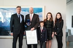 Joint Logistics Operations Center Executive Officer and retired Army Col. Eugene Shearer (second from left) and his family joined Canadian Ambassador to the United States Gary Doer (left) at the Canadian Embassy in Washington, D.C., Dec. 15.  Ambassador Doer presented the Canadian Meritorious Service Medal to Shearer for his service on behalf of Canadians as chief of the Combined Joint Logistics Branch within Regional Command South, Afghanistan, from May 2010 to June 2011. Photo by Keegan Bursaw