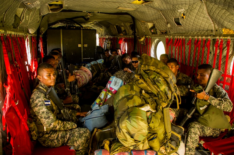 Honduran soldiers sit in the back of a U.S. Army CH-47 Chinook Dec. 16, 2015, prior to transiting to a remote area in the Gracias a Dios Department (state) of Honduras. The troops are a part of more than 4,900 Honduran troops the U.S. has helped to access hard to reach locations in the department since October 2014, where disrupting drug trafficking has been a primary focus for the Honduran government. (U.S. Air Force photo by Capt. Christopher Mesnard/Released)