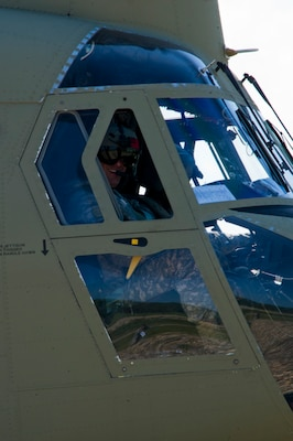 U.S. Army Chief Warrant Officer 3 Kyle Johnson, 1-228th Aviation Regiment pilot prepares to take off in a U.S. Army CH-47 Chinook Dec. 17, 2015, in the Gracias a Dios Department (state) of Honduras. (SOLDIERS NAME) is one of several aviators who helped airlift Honduran troops and supplies during the two-day mission, allowing the Hondurans to better move in a remote area they are making significant progress in disrupting the flow of illicit drugs and materials. (U.S. Air Force photo by Capt. Christopher Mesnard/Released)