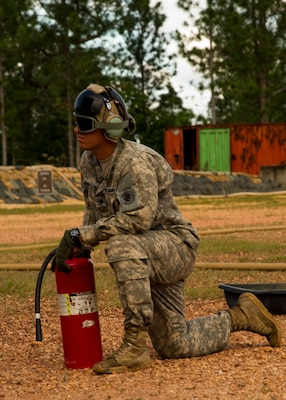 U.S. Army Cpl. Randy Moncivaiz, Joint Task Force-Bravo Petroleum, Oil and Lubricant team leader provides a safety over watch while a U.S. Army CH-47 Chinook is refueled Dec. 17, 2015, at Mocoron Airfield in the Gracias a Dios Department (state) of Honduras. The airfield provides the flying forces a hub to refuel at and embark from when conducting CARAVANA troop movements in the area. The troop movements are part of a combined U.S. and Honduran effort to limit the flow of illicit drugs and materials through the region. (U.S. Air Force photo by Capt. Christopher Mesnard/Released)