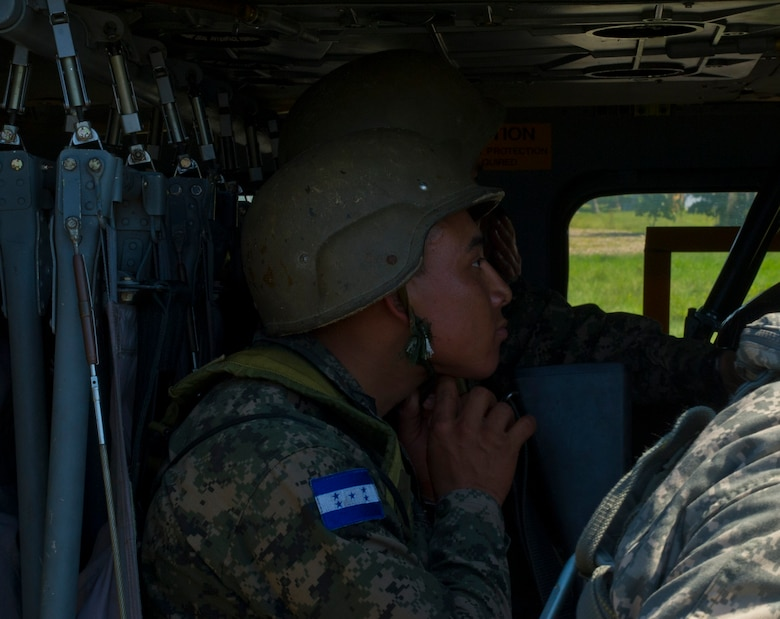 A Honduran soldier straps into a U.S. Army UH-60 Blackhawk Dec. 16, 2015, during U.S. supported troop movement in the Gracias a Dios Department (state) of Honduras. The troop was a part of more than 4,900 Honduran personnel the U.S. helped access hard to reach locations in the department since October 2014, where disrupting drug trafficking has been a primary focus for the Honduran government. (U.S. Air Force photo by Capt. Christopher Mesnard/Released)