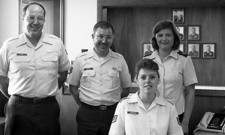 Mike Evans, Jack Jameson and Charlotte Brown gather for a photo with Tech. Sgt. Jean (Allen) Anderson, at the Portland Air National Guard Base, Ore., in 1990. Allen retired after more than 32 years of service on Dec. 22, 2015. (Air Nation Guard photo courtesy of the 142nd Fighter Wing History Office)