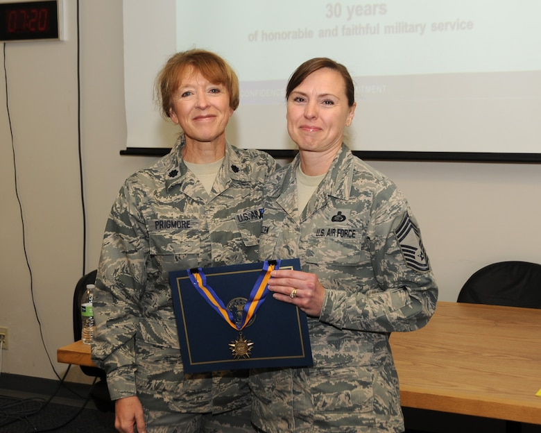 Chief Master Sgt. Jean Allen receives recognition for 30 years of dedicated service from the Commander of the 142nd Force Support Squadron, Col. Donna Prigmore, Portland Air National Guard Base, Ore., Nov. 2, 2013. (Air National Guard photo by Master Sgt. Shelly Davison, 142nd Fighter Wing Public Affairs)