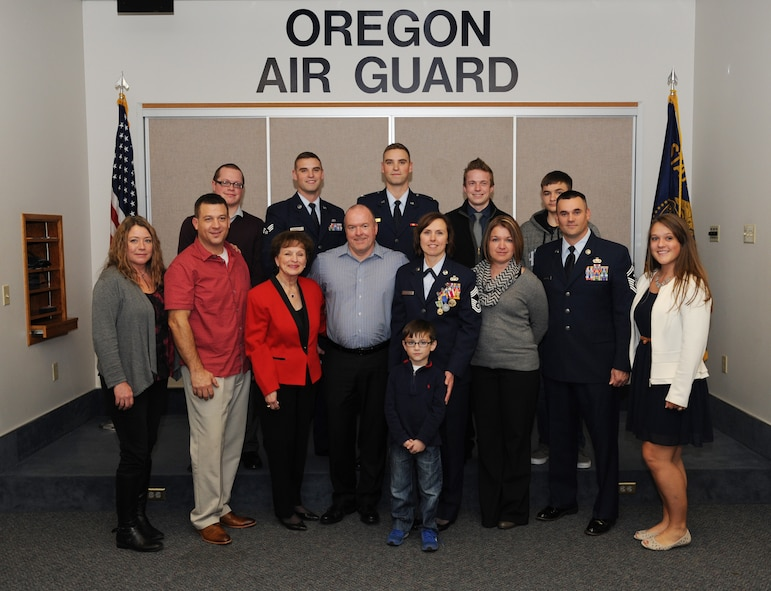 Family members of Chief Master Sgt. Jean Allen gather for a photograph following her formal retirement ceremony, Dec. 22, 2015, Portland Air National Guard Base, Ore. (Air National Guard photo by Tech. Sgt. John Hughel, 142nd Fighter Wing Public Affairs)