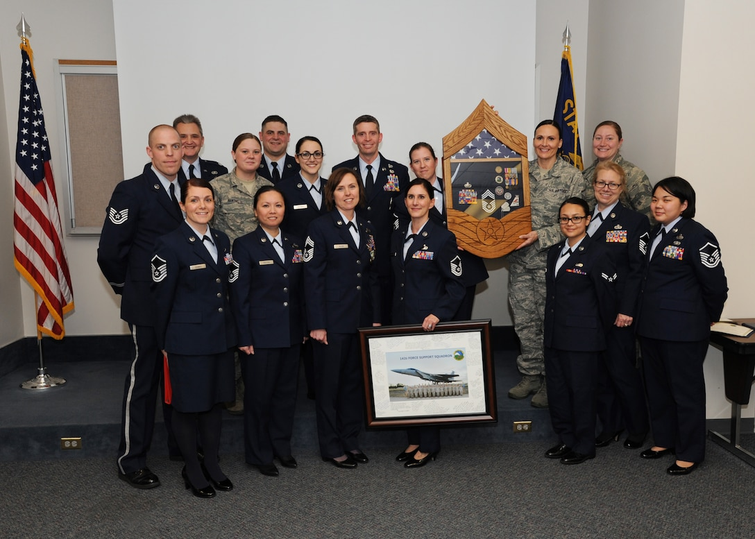 Members of the 142nd Fighter Wing Force Support Squadron gather for a group photograph after presenting several awards of recognition to Chief Master Sgt. Jean Allen, (center front row) during her retirement ceremony, Dec. 22, 2015, Portland Air National Guard Base, Ore. (Air National Guard photo by Tech. Sgt. John Hughel, 142nd Fighter Wing Public Affairs)