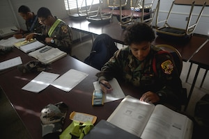 """Devin Dunn, a cadet with the Maryland National Guard's Freestate ChalleNGe Academy, which provides a means for """"at risk"""" 16-to-18-year-olds to earn their GED certificate or high school diploma, works through math problems during class at the academy, Nov. 17, 2015. Part of the National Guard's Youth ChalleNGe Program, which includes 37 academies throughout the country, the Freestate ChalleNGe Academy opened in 1993 and was one of the first academies of the program."""