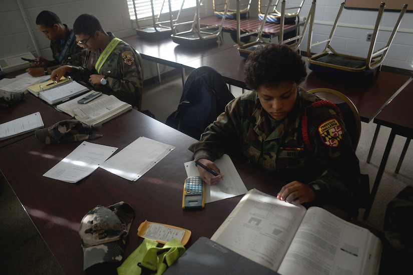 "Devin Dunn, a cadet with the Maryland National Guard's Freestate ChalleNGe Academy, which provides a means for ""at risk"" 16-to-18-year-olds to earn their GED certificate or high school diploma, works through math problems during class at the academy, Nov. 17, 2015. Part of the National Guard's Youth ChalleNGe Program, which includes 37 academies throughout the country, the Freestate ChalleNGe Academy opened in 1993 and was one of the first academies of the program."
