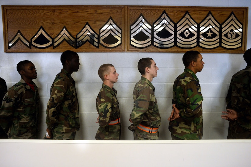 Cadets with the Maryland National Guard's Freestate ChalleNGe Academy stand at the position of parade rest while waiting in line at the academy's mess hall, Nov. 17, 2015. The Youth ChalleNGe program follows a quasi-military program of instruction as a way to instill discipline and esprit-de-corps in cadets.