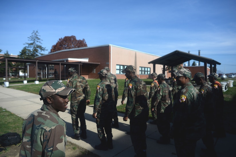 "The rhythm of boots marching in unison echoes off the surrounding buildings as a cadet with the Maryland National Guard's Freestate ChalleNGe Academy marches his platoon to the academy's mess hall, Nov. 17, 2015. For cadets at the academy—part of the National Guard's Youth ChalleNGe Program, which provides a path for ""at-risk"" youth to  receive a GED or high school diploma—marching is an everyday part of life at the academy where a military-style boot camp environment is used to create structure and build discipline among cadets."