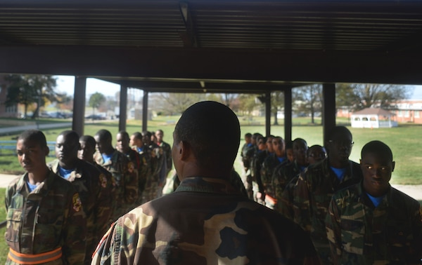 All eyes are on the platoon leader as cadets at the Maryland National Guard's Freestate ChalleNGe Academy wait in formation for the command to enter the academy's mess hall for lunch, Nov. 17, 2015. Part of the National Guard's Youth ChalleNGe program, the Freestate Academy follows a quasi-military program of instruction as a way to instill discipline and esprit-de-corps in cadets.