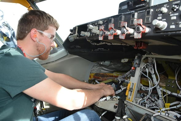 Michael Johnson, an electrician with the 564th Aircraft Maintenance Squadron prepares wiring for installation of new liquid crystal displays in a KC-135 cockpit at Tinker Air Force Base Dec. 22, 2015. The new displays are part of the latest KC-135 Stratotanker upgrade called Block 45 which will be retro fitted into Air Force Reserve Command jets in the 507th Air Refueling Wing starting in Feb. 2016. (Air Force Photo/Maj. Jon Quinlan)