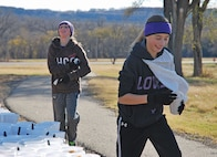 Yasmeena Grindle, left, daughter of Rebecca and Capt. David Grindle, commander of the 1st Replacement Company, U.S. Army Garrison Fort Riley and Mariah Brackett, daughter of Jessica and retired Soldier Joe Brackett, participate in the Gobble Wobble Thanksgiving race Nov. 21.