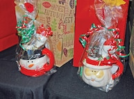Members brought objects like the mugs full of good¬ies, above, that they made, bought or baked for the annual Make it, Bake it, Fake it luncheon at Riley's Conference Center Nov. 19.