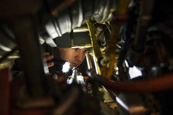 U.S. Air Force Staff Sgt. Michael White, 19th Maintenance Squadron aerospace propulsion journeyman, inspects the inside of a C-130J engine Dec. 29, 2015, at Little Rock Air Force Base, Ark. White ensured the engine was free from foreign object debris such as rubber, metal or leaves. (U.S Air Force photo/Senior Airman Harry Brexel)