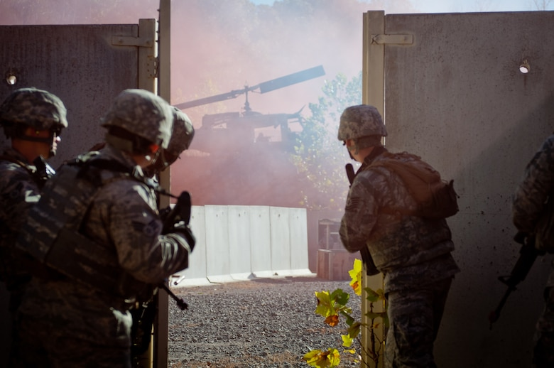 Members of the Kentucky Air National Guard's 123rd Security Forces Squadron assess the battlefield during a field training exercise at Ft. Knox, Ky., Oct. 20, 2015. Unit members were being evaluated on their ability to extract a downed pilot from a simulated Afghan village. (Kentucky Air National Guard photo by Master Sgt. Phil Speck)