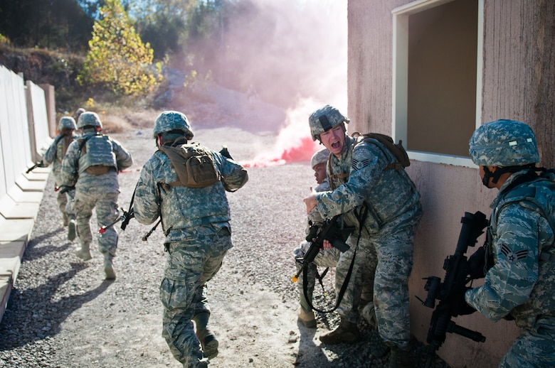 Tech. Sgt. Julien Borchert, a squad leader for the Kentucky Air National Guard's 123rd Security Forces Squadron, shouts commands during a field training exercise at Ft. Knox, Ky., Oct. 20, 2015. Unit members were being evaluated on their ability to extract a downed pilot from a simulated Afghan village. (Kentucky Air National Guard photo by Master Sgt. Phil Speck)