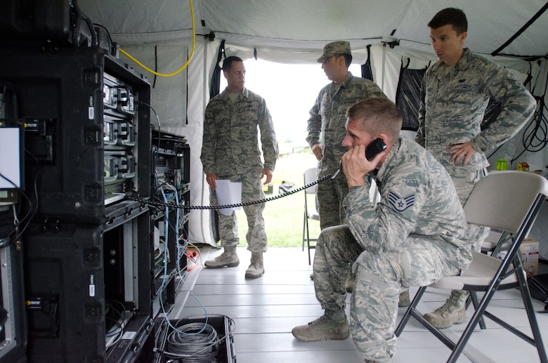Staff Sgt. Chance Harrig, NCOIC of radio frequency communications for the 123rd Communications Flight, tests telephone capabilities during a state-wide communication exercise at the Kentucky Air National Guard Base in Louisville, Ky., June 25, 2015. The Kentucky National Guard and multiple federal, state and local agencies participated in the week-long exercise, designed to test the agencies' ability to communicate with each other during emergencies. (Kentucky Air National Guard photo by Master Sgt. Phil Speck)