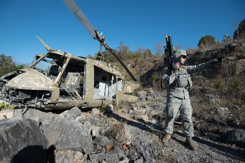 Senior Airman Randy Roberts, a Fire Team leader from the Kentucky Air National Guard's 123rd Security Forces Squadron, directs efforts to recover a simulated downed pilot inside a mock Afghan Village at Fort Knox, Ky., Oct. 20, 2015. Roberts and his fellow Airmen were required to execute a coordinated search while defending their positions and engaging hostile forces. (U.S. Air National Guard photo by Maj. Dale Greer)