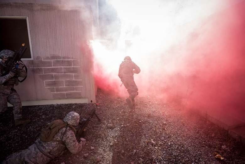 Fire Team members from the Kentucky Air National Guard's 123rd Security Forces Squadron conduct training to recover a downed pilot inside a simulated Afghan Village at Fort Knox, Ky., Oct. 20, 2015. The Airmen were required to execute a coordinated search while defending their positions and engaging hostile enemy forces. (U.S. Air National Guard photo by Maj. Dale Greer)