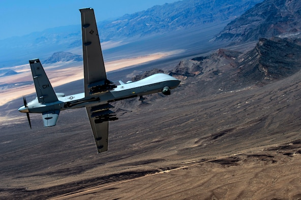 An MQ- Reaper remotely piloted aircraft performs aerial maneuvers over Creech Air Force Base, Nev., June 25, 2015. The MQ-9 Reaper is an armed, multi-mission, medium-altitude, long-endurance remotely piloted aircraft that is employed primarily as an intelligence-collection asset and secondarily against dynamic execution targets. (U.S. Air Force photo by Senior Airman Cory D. Payne/Released)