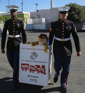 Marines collect toys and donations for the Toys for Tots program throughout Southern California, Dec. 18, 2015. This group of Marines collected 700 gifts, 600 bicycles, and more than $1,000 in donations for children over the holidays. The Marines are with 7th Engineer Support Battalion, 1st Marine Logistics Group, I Marine Expeditionary Force.