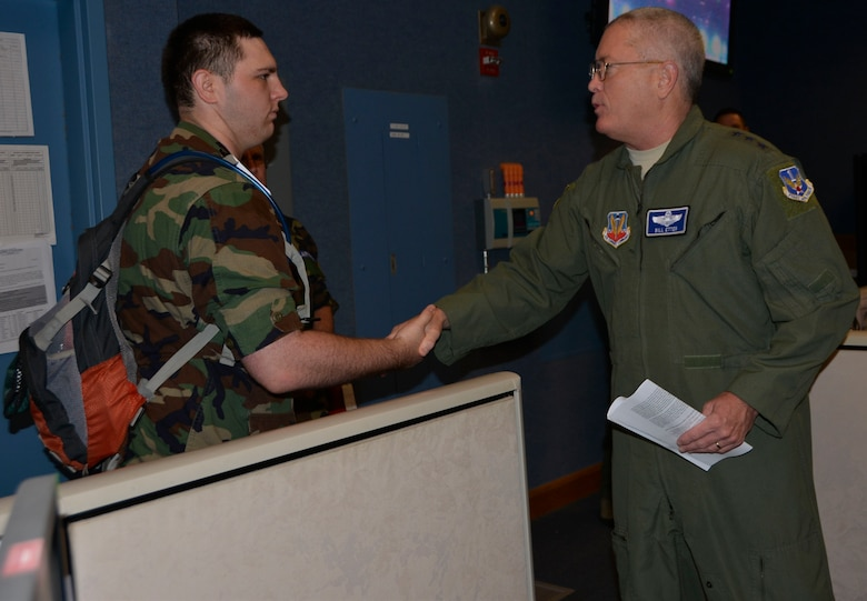 TYNDALL AIR FORCE BASE, Fla. - Lt. Gen. William Etter, Continental  U.S. North American Aerospace Defense Command Region – 1st Air Force (Air Forces Northern) commander, presents his commander's coin for recognition of superior performance  to Civil Air Patrol Cadet/2d Lieutenant  Steven Conway of Lake Composite Squadron Fl-021 during a CAP cadet tour of the 601st Air Operations Center Wednesday. Conway is a CAP Silver Medal of Honor recipient who distinguished himself when, during a visit to a local store, he rushed to a store worker under attack by a man wielding a knife. He pulled the man off the worker and is credited by police for probably saving the woman's life. The attacker fled but was subsequently captured by authorities shortly thereafter. Conway and the other cadets were visiting the 601st AOC as part of their annual week-long winter encampment event designed provide an in-depth orientation to the Civil Air Patrol and the United States Air Force. (Air Force Photo Released/Mary McHale)