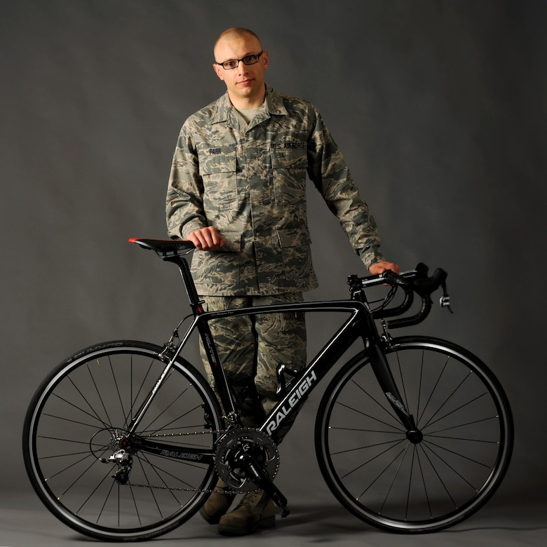 Oregon Air National Guard Tech. Sgt. Dwayne Farr, assigned to the 142nd Fighter Wing Aircraft Maintenance Squadron, poses with one of his bicycles during a photo shoot at the air base Public Affairs office, Portland Air National Guard Base, Ore., April 7, 2013. Farr has been training and racing as an endurance cyclist during the past four years and was part of the Military World Games in Mungyeoung, Korea, October 6, 2015. (U.S. Air National Guard photo by Tech. Sgt. John Hughel, 142nd Fighter Wing Public Affairs/Released)