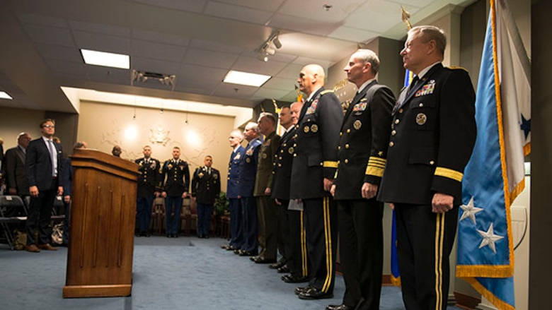 """Members of the Joint Chief of staff stand at attention for the signing of a """"28-star"""" Letter at the Pentagon, Feb. 2, 2015.  The letter challenges transitioning service members to continue serving their community and encouraged greater involvement between veterans and the public.  (U.S. Marine Corps photo by Sgt. Jose D. Lujano/released)"""