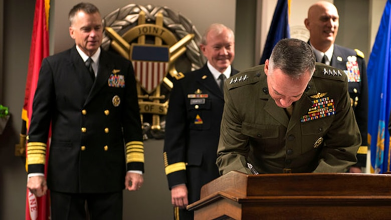 """The 36th Commandant of the Marine Corps Gen. Joseph Dunford signs a """"28-star"""" Letter at the Pentagon, Feb. 2, 2015. The letter challenges veterans, who have served since 9/11, to continue being leaders and becoming assets in their communities following the end of their active-duty military career."""