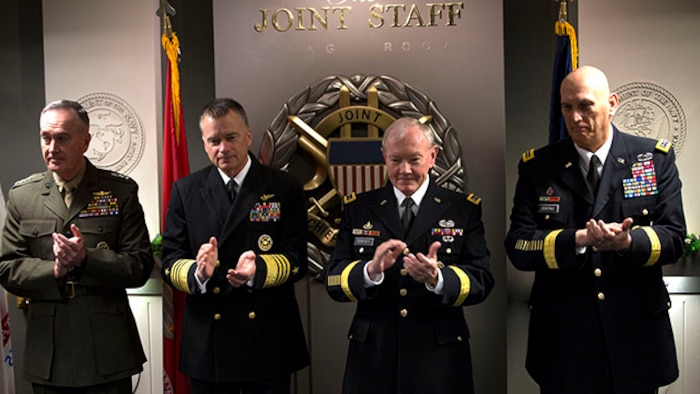 """Members of the Joint Chiefs of staff applaud for the conclusion of the signing of the """"28-star"""" Letter at the Pentagon, Feb. 2, 2015.  The letter challenges transitioning service members to continue serving their community and encouraged greater involvement between veterans and the public.  (U.S. Marine Corps photo by Lance Cpl. Remington Hall/released)"""